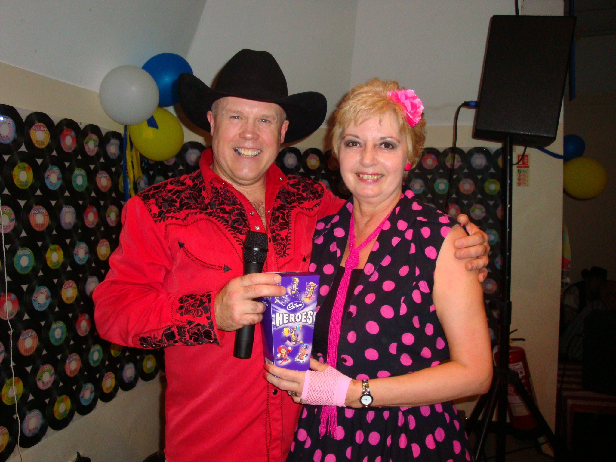 Alan Gregory presenting Sandy with best prize for fancy dress costume - New Year 2011